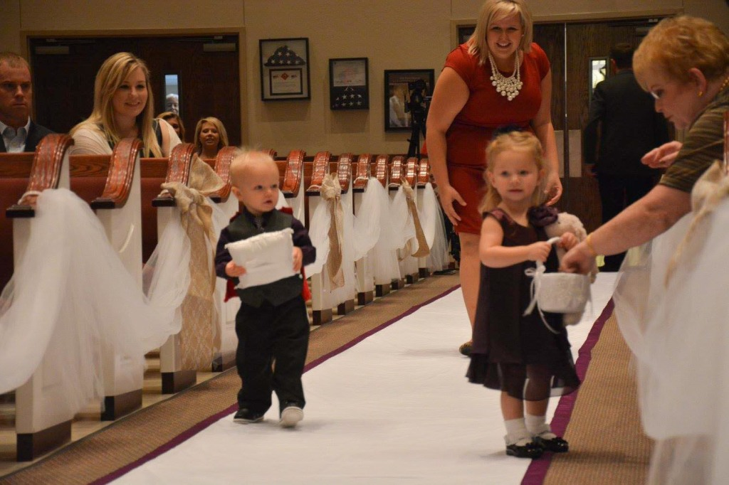 Maddie with Eli the ring bearer (Photo © Jennifer Reynolds at Dottie Loo Photography, used with permission)