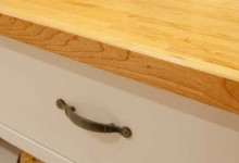 Closeup detail of new cherry butcherblock countertop installed on Ikea VÄRDE Base cabinet